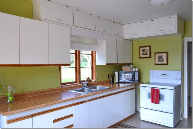 green kitchen with cupboards