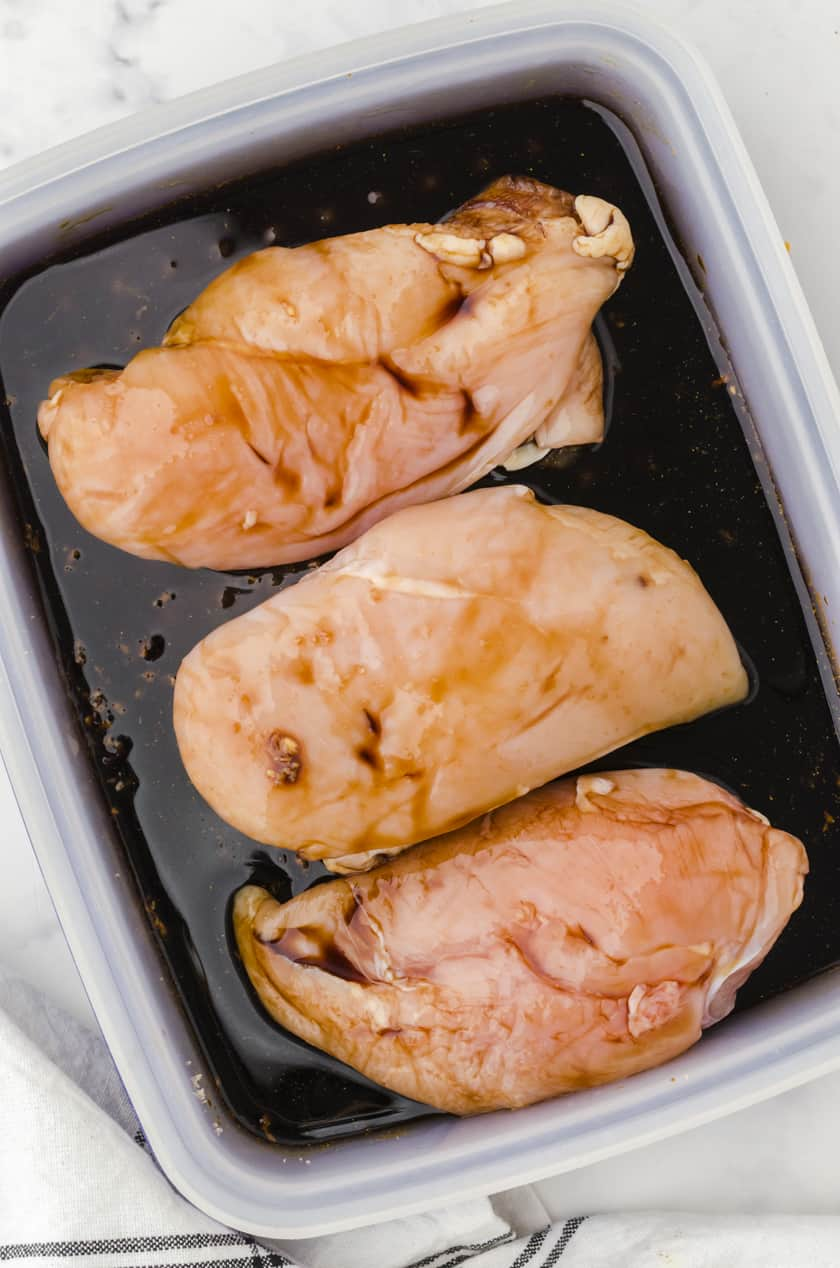 Place the chicken in the container with marinade and flip over so both sides are coated well.