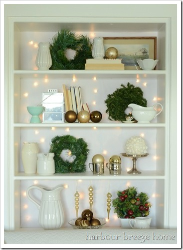christmas bookcase with twinkles at harbourbreezehome.com