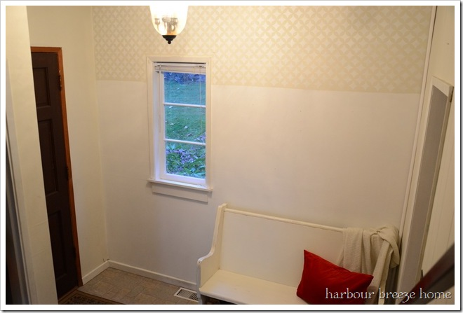 stenciled wall in entry
