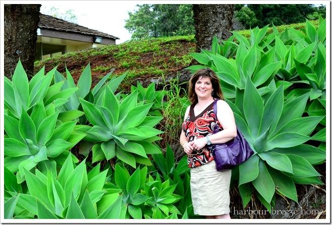 rita in front of big plants