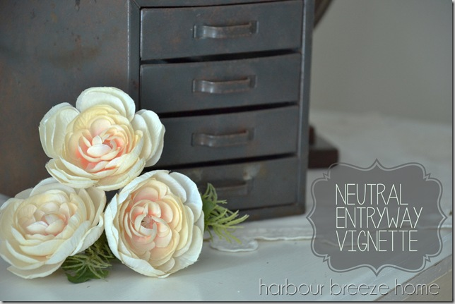 neutral entryway vignette with words