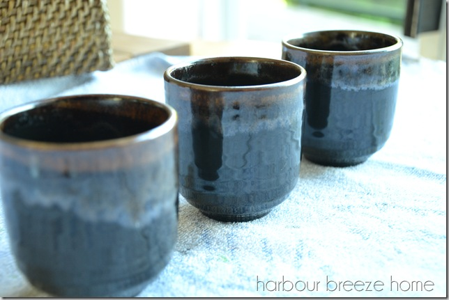 Dark brown glazed pottery mugs from thrift store.