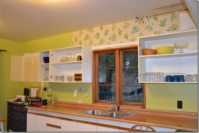 vintage wallpaper on before kitchen | harbourbreezehome.com