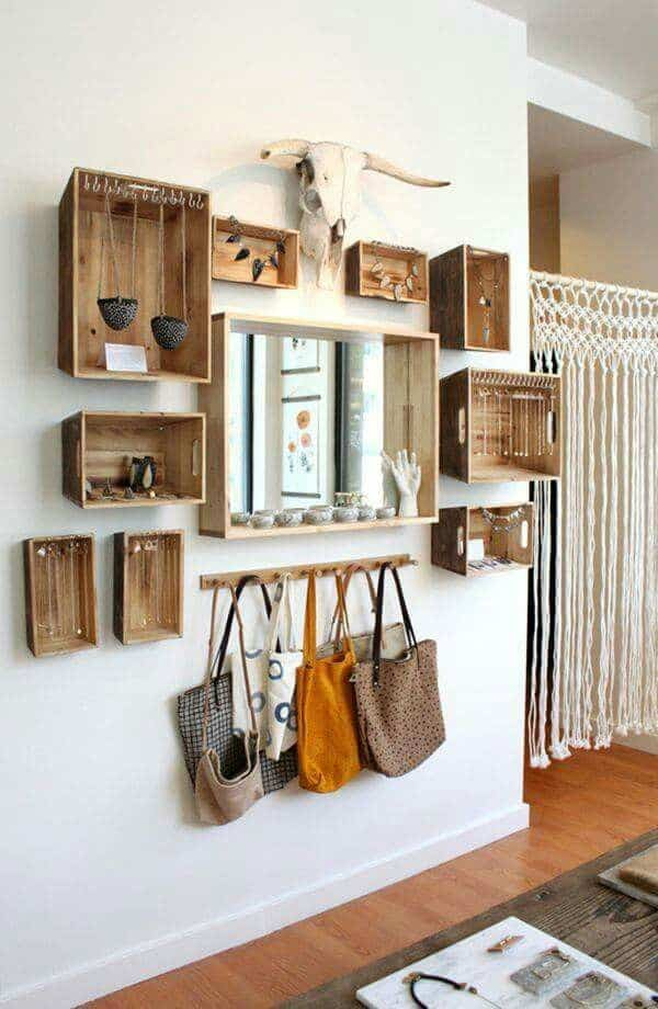 a blank wall becomes a beautiful and functional organization system with hanging wooden boxes with hooks for hanging necklaces, purses, and jewelry