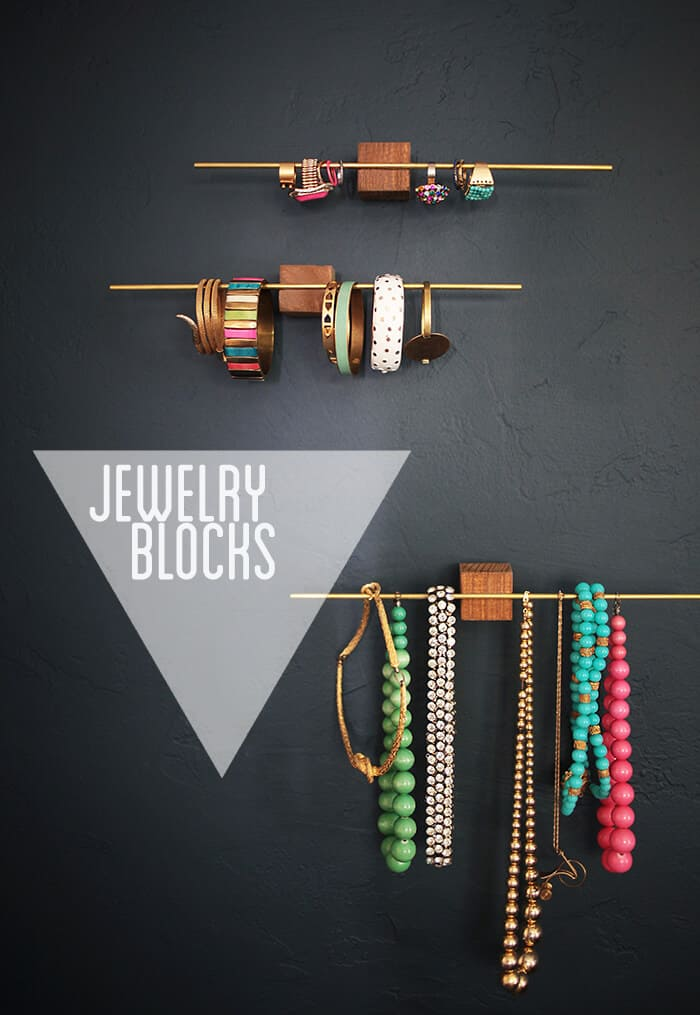 Thin metal rods adhered to wooden blocks becomes a stunning modern designed jewelry holder.