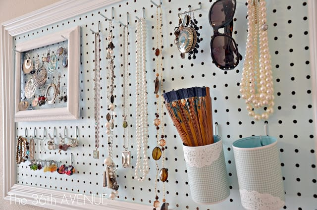 a pegboard is transformed into a jewelry and accessories organizer with strategically placed hooks for necklaces, earrings, and sunglasses