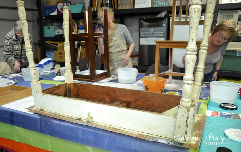a desk sitting on a table upside down ready to be painted