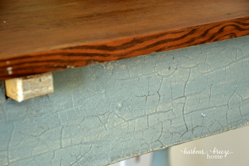 close up of desk with country chic elegance paint color and dark stained wood top