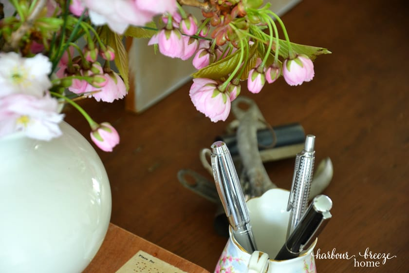 pink flowers on the corner of a desk