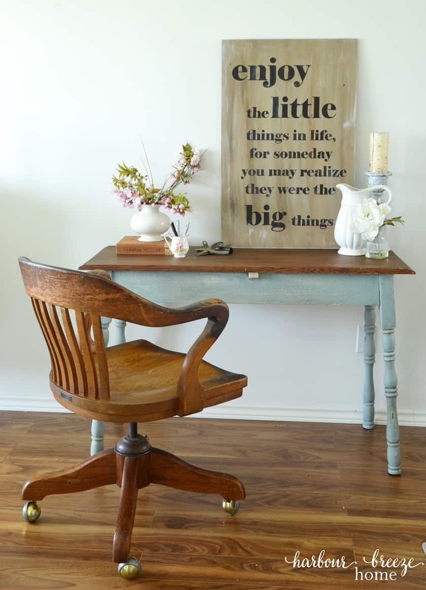 picture of farmhouse table with antique oak office chair sitting in front