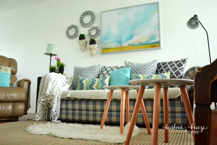 blue checked couch with watercolor landscape picture from Minted above it