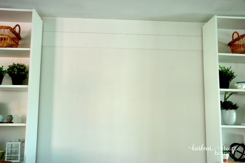 first two boards on the wall for a farmhouse shiplap look