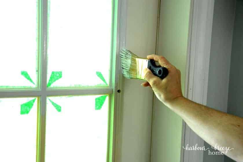 Prime plastic door trim with a handle less trim paint brush first.