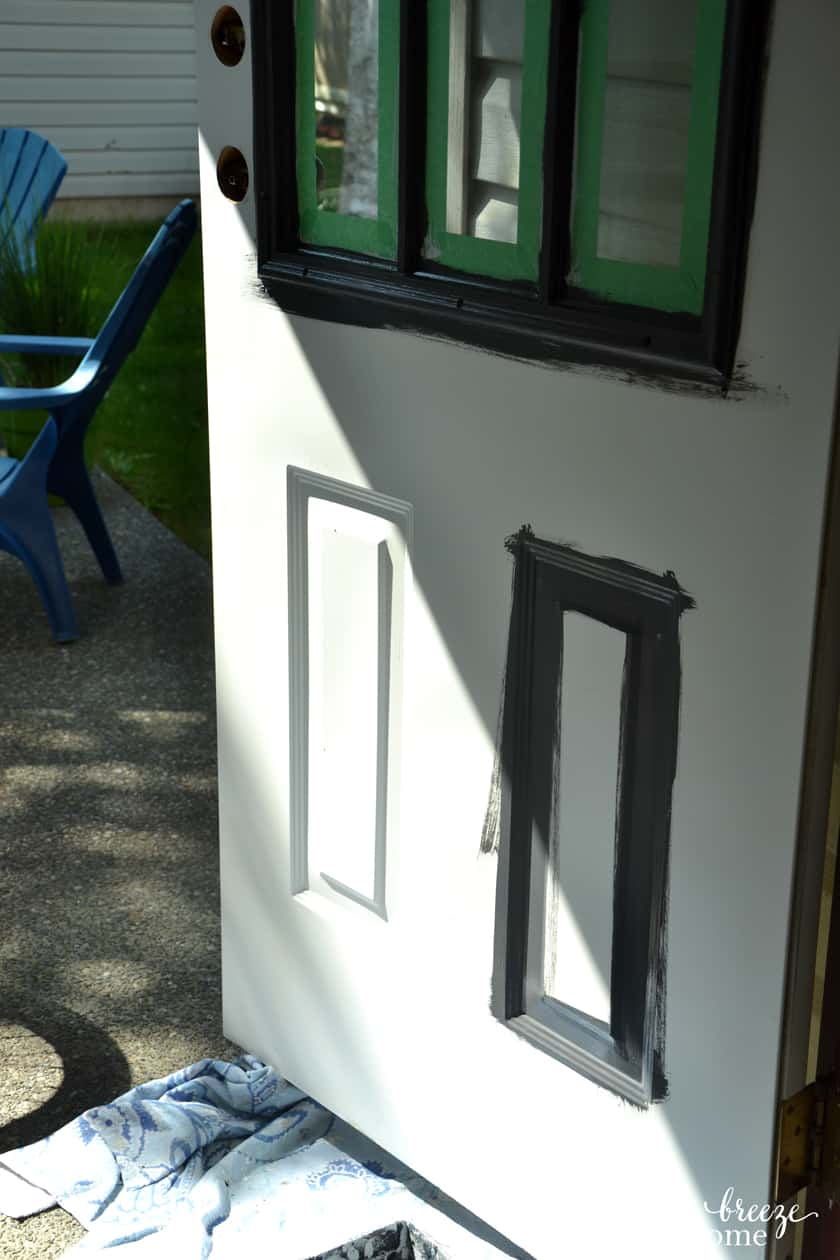 The second step of painting an exterior metal door is to paint any recessed areas in the door.