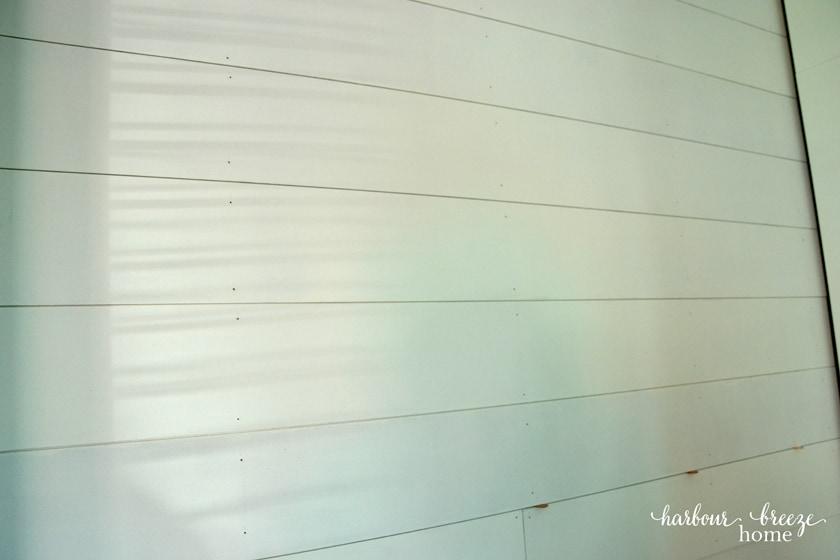 DIY Shiplap Walls using pennies as spacers