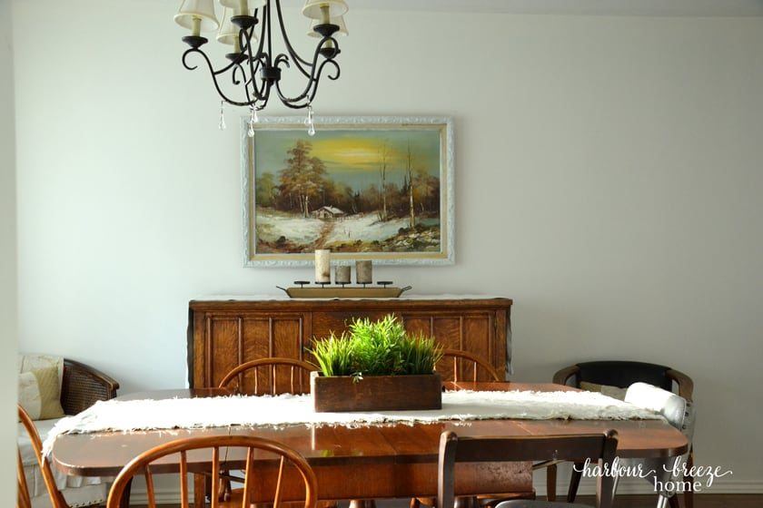 Antique Buffet in Dining Room with Vintage Art print hung above it