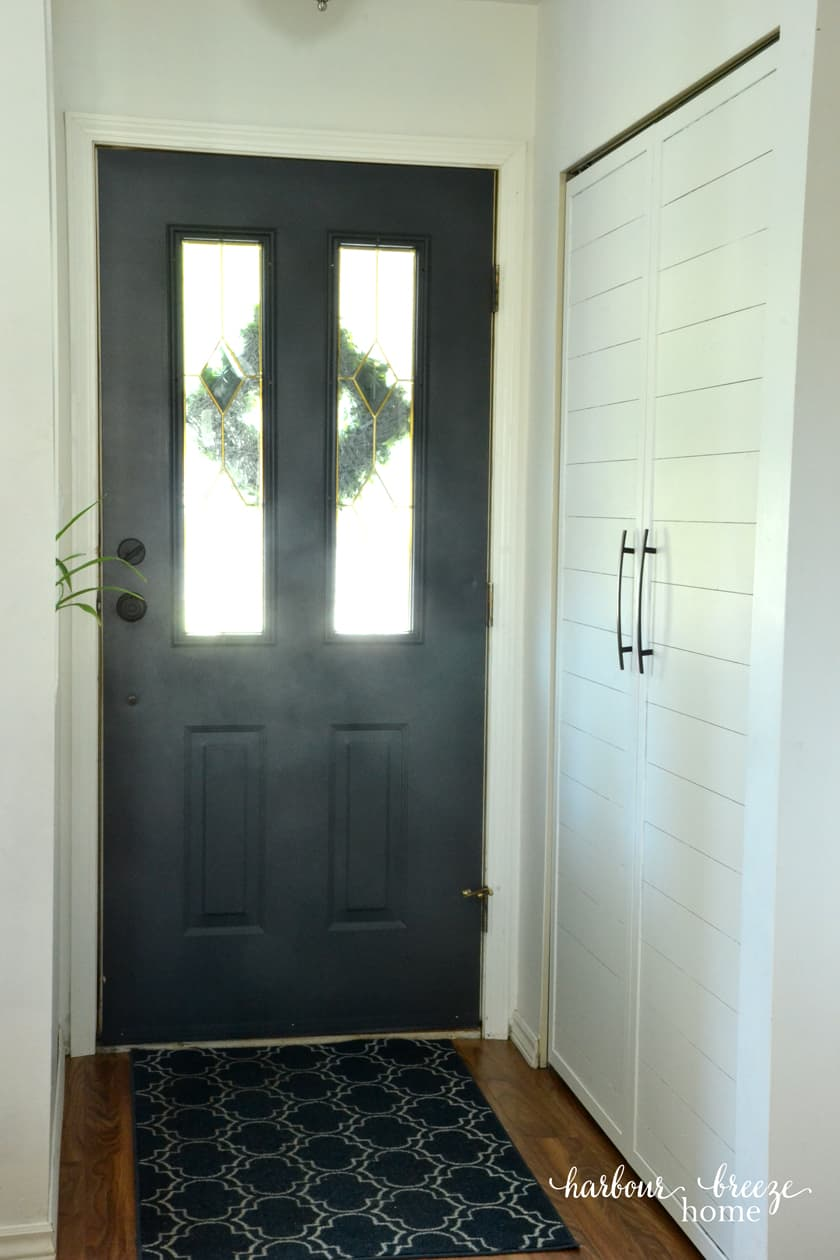 The back of a front door painted the color Raccoon Fur by Benjamin Moore