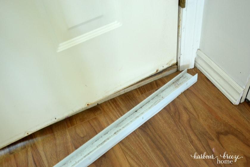 a vinyl door sweep removed from the bottom of a door