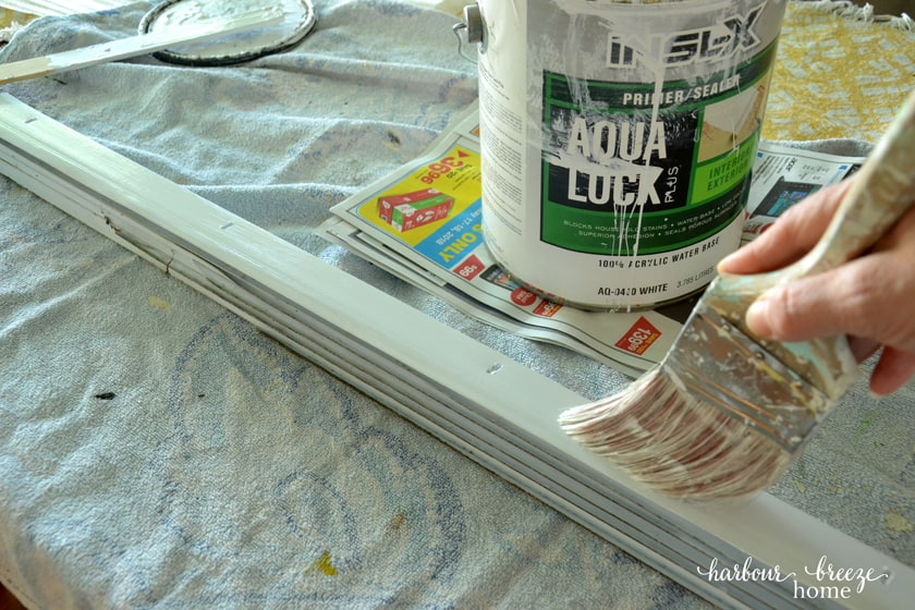 applying paint primer with a brush