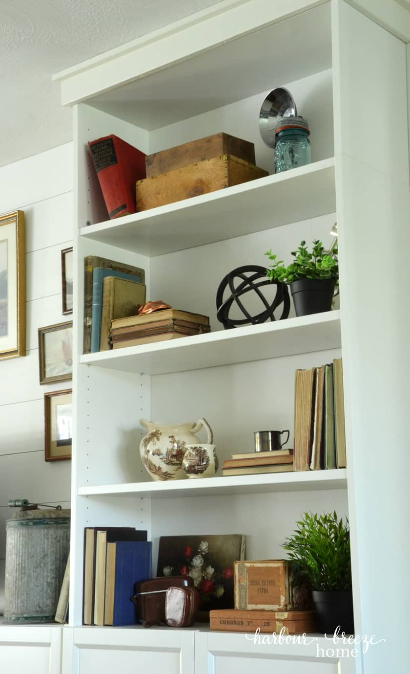 Billy Bookcases styled with vintage boxes, greenery, old china, and books