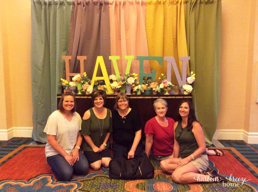 Haven sign with women in front of it