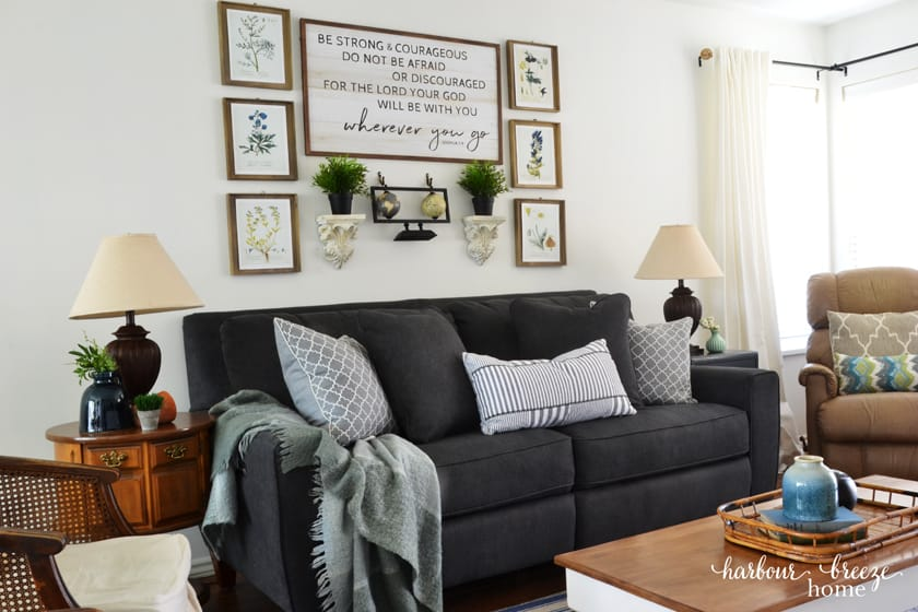 Dark Gray Edie La-Z-Boy Sofa in townhouse living room with lamps to the sides and pictures above it