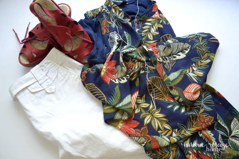 Summer outfit of white capri pants, blue t-shirt and sleeveless kimono