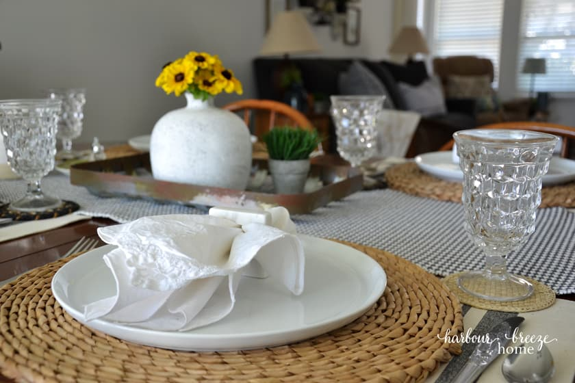 A table set with the living room in the background