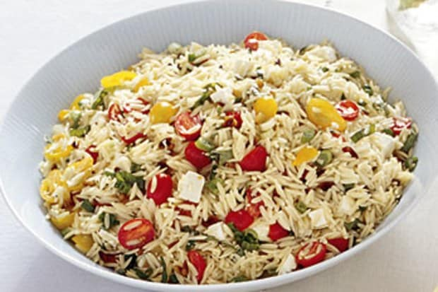 Orzo salad in a white serving bowl