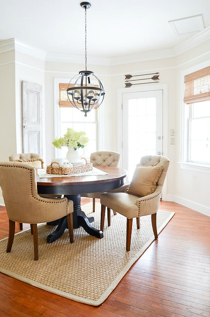 round dining room table in a small white painted nook