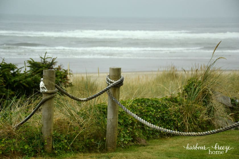 fence by the beach made with posts and rope