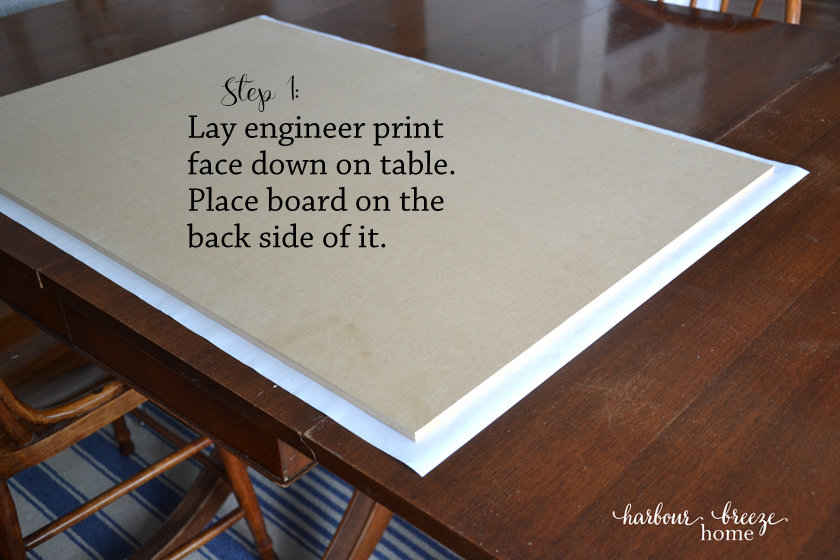 an engineer print laying face down on a table with an mdf board on it