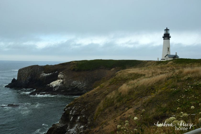 Lighthouse standing on a rocky cliff ~ Yaquina Head Lighthouse