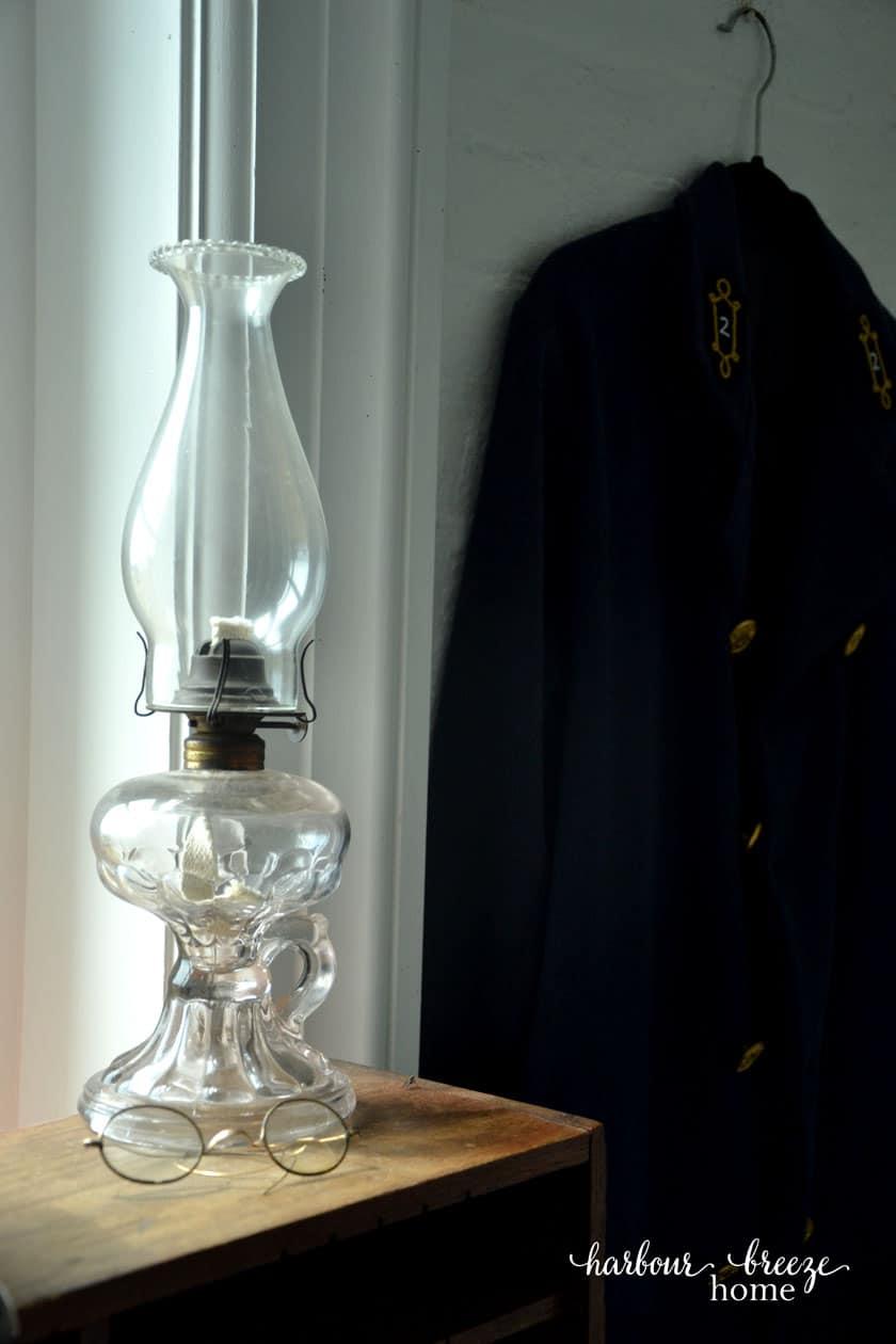 oil lantern by a window