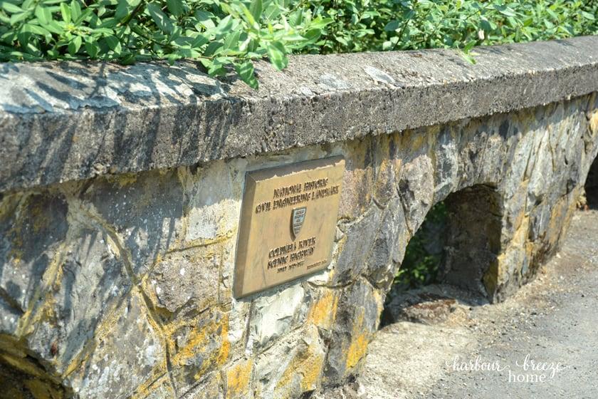 rock wall beside a walking path
