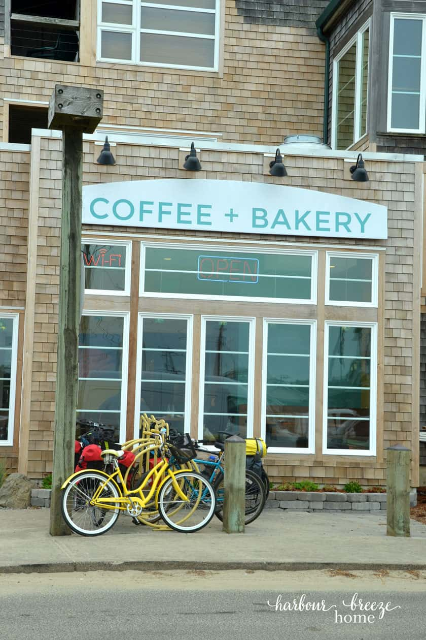 coffee shop with bikes parked in the front