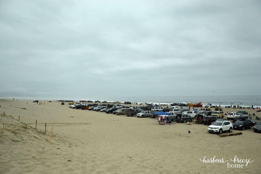 cars parked on a sandy beach