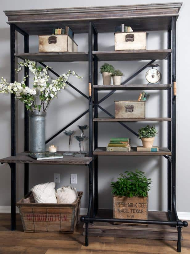 A joanna gaines bookcase that is styled to look like a classic farmhouse bookcase.