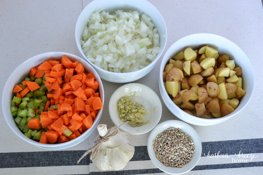 3 bowls filled with chopped vegetables ~ carrots & celery, onions, & diced potatotoes