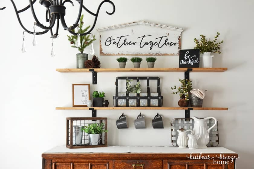 Easy DIY Farmhouse Shelves placed above an antique oak buffet in a dining room