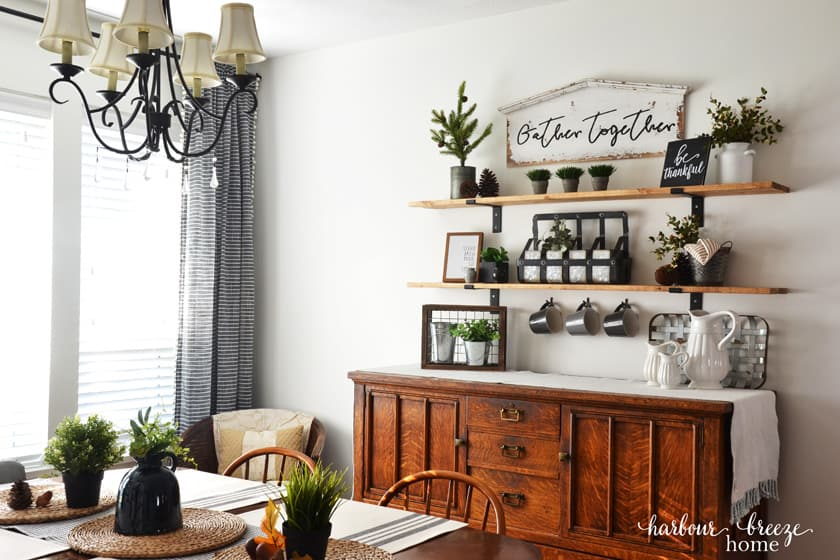Dining Room table with buffet behind it and farmhouse shelves above it