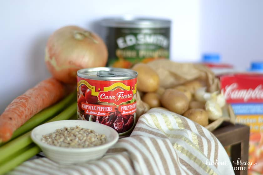 Soup ingredients with a focus on a can of chipolte peppers