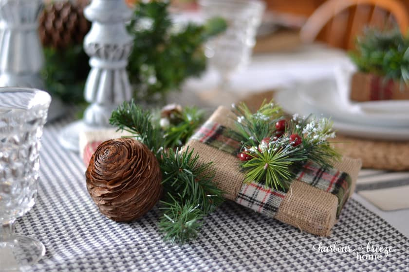 burlap wrapped gift centerpiece on a farmhouse christmas table setting