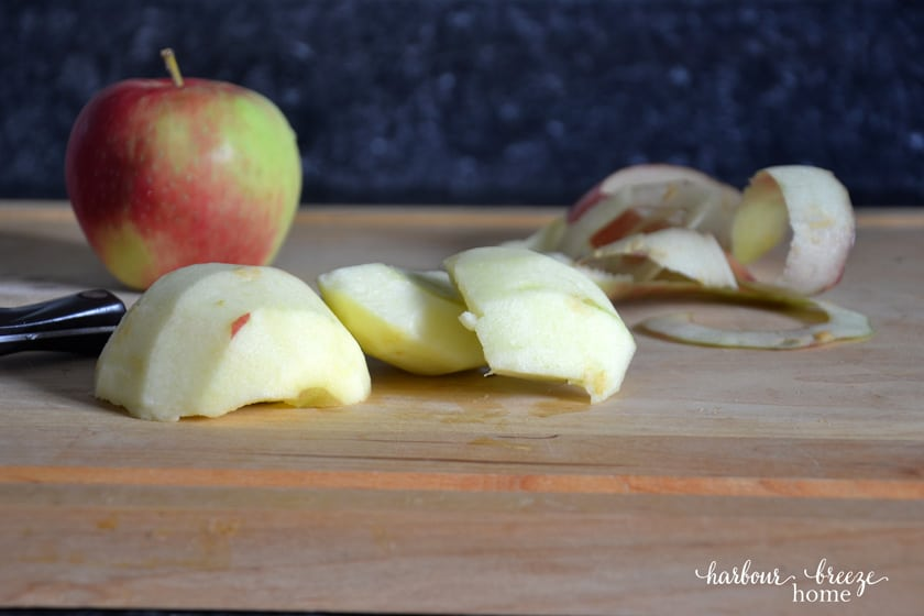 peeled apple chunks on a cutting board