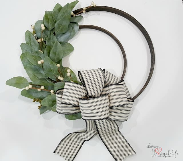 homestyle gathering 4 double hoop wreath with bow and greenery on wall