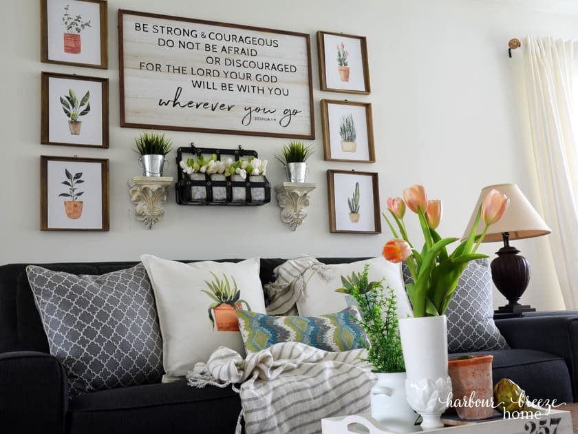 Gallery wall with free watercolor plant printables and pillows made with Avery iron on transfers