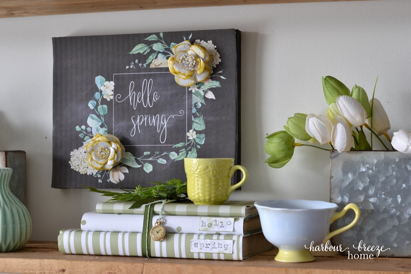"""Hello Spring"" wall decor art hung in the back of a shelf for Spring Dining Room decor ideas."