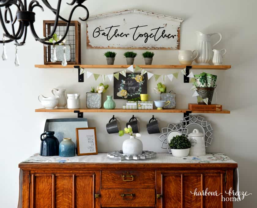 Farmhouse shelves in a dining room decorated with Spring decor ~ including a Spring green paper triangle banner