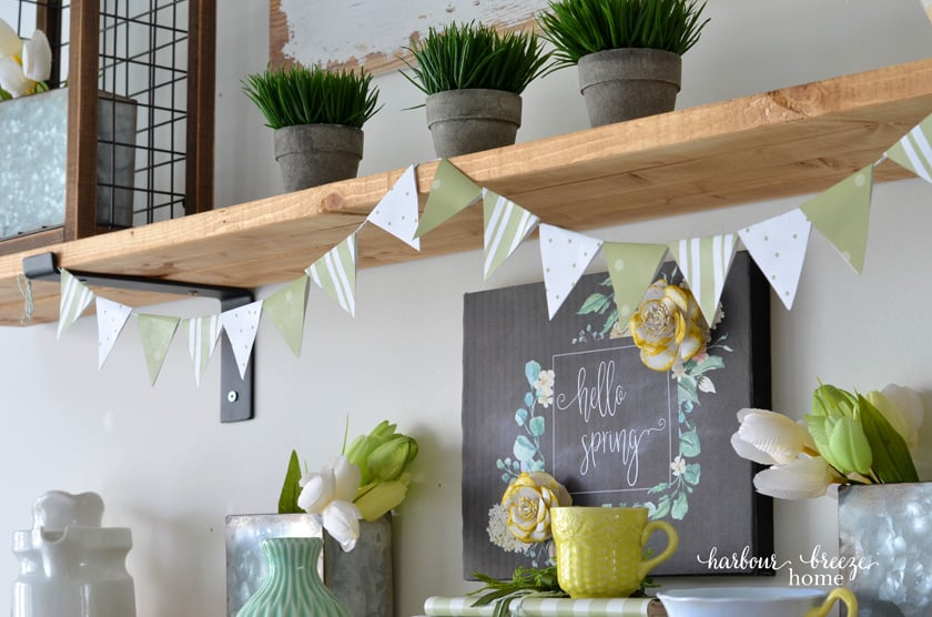 paper triangle bunting banner hanging on a farmhouse shelf